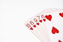 纸牌游戏手等级符号集纸牌在赌博娱乐场:在白色背景,运气摘要的同花顺 免版税库存图片
