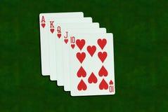 纸牌游戏手,同花大顺 库存图片