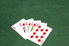 纸牌游戏手-同花大顺 免版税库存图片