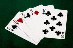 纸牌游戏手-四张相同的牌-五和八 免版税库存图片