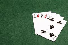 纸牌游戏手-四张相同的牌 库存照片