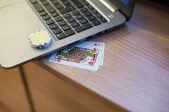 纸牌芯片笔记本4 免版税库存图片