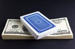 纸牌金钱和甲板  免版税库存图片
