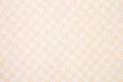 纸纹理在温暖的米黄奶油树荫一个单一色小细胞的艺术品的 现代背景,背景 免版税库存照片