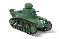 纸老苏联坦克的模型在白色背景的 左眼睛 体力活儿,爱好的概念 免版税库存图片