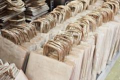 纸袋在仓库商店 免版税图库摄影