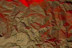 纸被弄皱的纹理黄色红色质地背景 库存图片