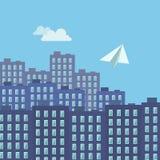 纸飞机在城市 免版税库存照片