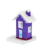 纸紫罗兰色圣诞节房子盖了雪 免版税库存图片