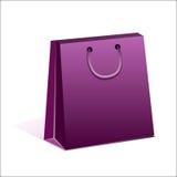纸紫罗兰色购物袋 免版税图库摄影
