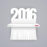 纸2016年被切开成在灰色的切菜机 免版税库存图片
