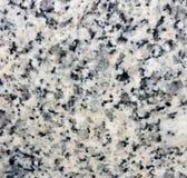 纹理和灰色花岗岩石头无缝的背景  免版税库存照片