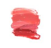 纹理样品和嘴唇的一支双重唇膏 免版税图库摄影