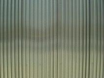 纹理穿孔钢板和波浪 免版税库存照片