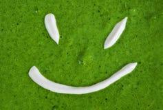 纹理菠菜奶油汤微笑 免版税库存照片