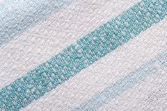 纹理镶边的棉织物关闭。宏指令。 免版税库存照片
