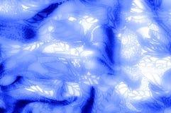 纹理 图画 背景 在白色布料后面的蓝色花 图库摄影