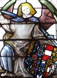 纹章玻璃中世纪面板被弄脏的视窗 库存照片