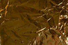 纺织材料金黄背景  免版税库存照片