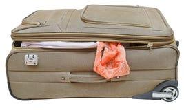 纺织品手提箱与掉下来女性内裤 免版税库存照片