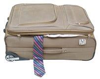 纺织品手提箱与掉下来被隔绝的领带 免版税库存照片