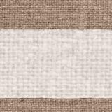 纺织品桌布,织品空间,浅黄色的帆布,成颗粒状的材料,古板的背景 库存照片