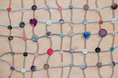 纺织品绳子网络与被连接的按钮的 免版税库存照片
