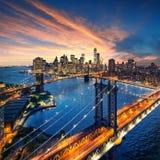 纽约-在曼哈顿的美好的日落有曼哈顿和布鲁克林大桥的 免版税库存图片