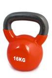 练习红色举重的16 kg 库存照片
