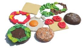 组分分离是黑暗的巧克力汉堡的造型黏土 免版税库存图片