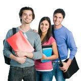 组愉快的微笑的学员 免版税库存图片