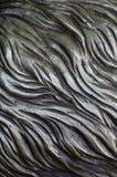 细节和装饰浅浮雕装饰品从伪造的盖印的铁门金属当背景纹理 图库摄影