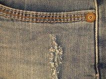 细节的蓝色牛仔布牛仔裤口袋关闭 库存图片