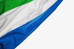 织品塞拉利昂旗子与copyspace的您的在白色背景的文本的 库存例证