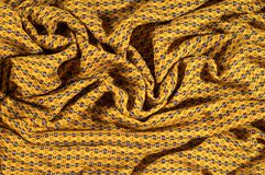 织品棉花是棕色的与圈子的样式 使光滑和池氏 库存图片