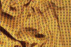 织品棉花是棕色的与圈子的样式 使光滑和池氏 免版税图库摄影