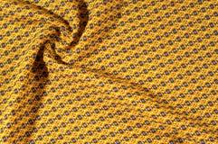 织品棉花是棕色的与圈子的样式 使光滑和池氏 库存照片