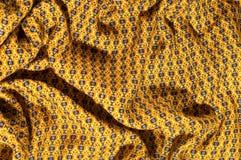 织品棉花是棕色的与圈子的样式 使光滑和池氏 免版税库存图片