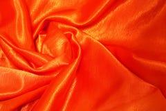 织品橙红缎 免版税库存照片