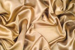 织品由丝织物金属螺纹金属光泽金子制成 Jus 免版税库存图片