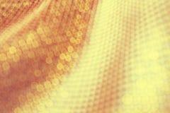 织品的纹理,边,织品背景在聚焦的 金黄颜色 免版税库存照片