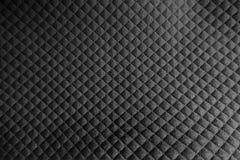 织品表面与压印的正方形的 免版税库存图片