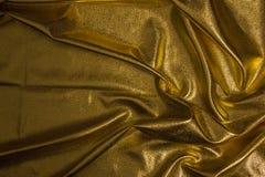 织品金黄织品波浪背景纹理  免版税库存照片