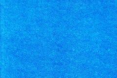 织地不很细纸明亮的蓝色背景与纤维和包括的 免版税库存图片
