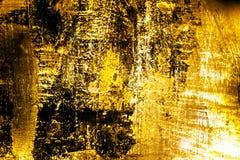织地不很细金黄金属背景 免版税库存图片