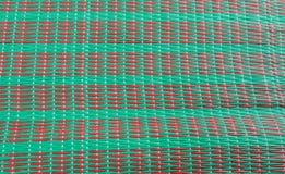 织法席子纹理在绿色和红颜色的 免版税库存图片
