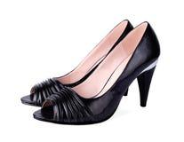 经典被停顿的高s穿上鞋子妇女 库存照片