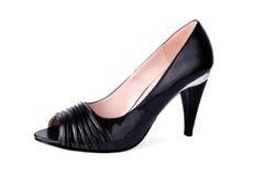 经典被停顿的高s穿上鞋子妇女 库存图片