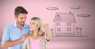 结合拿着在小插图前面的关键房子家图画 库存照片