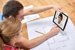 结合有与建筑师的视频通话 图库摄影